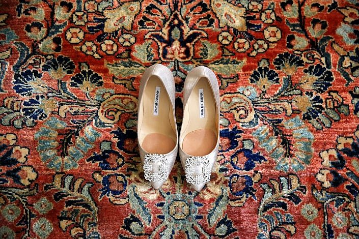 Manolo Blahnik wedding shoes on an oriental rug