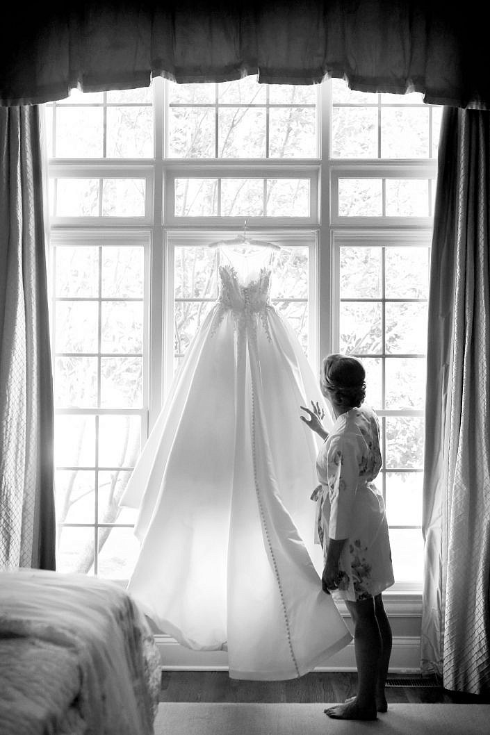 bride admires her wedding gown