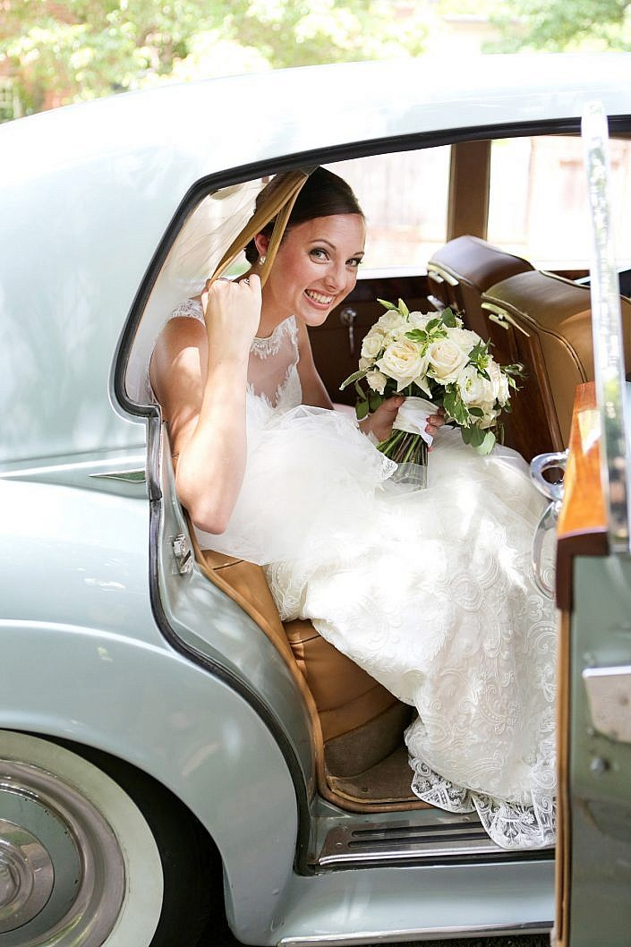 bride in vintage getaway car
