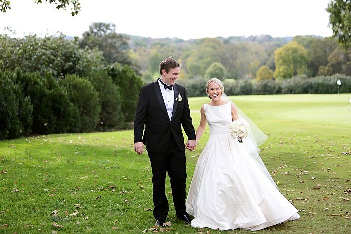 bride and groom walk on the golf course at belle meade country club